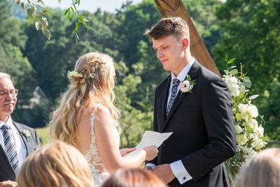 Wedding vows during ceremony at Claxton Farm in Weaverville, near Asheville, NC