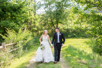 Bride and groom walking at Claxton Farm in Weaverville, NC