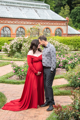 Couple touching foreheads during maternity photography at Biltmore Estate in Asheville