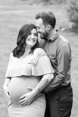 Maternity portrait of couple at Biltmore Estate in Asheville