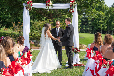 Bride and groom at altar at wedding at Omni Grove Park Inn Seely Pavilion