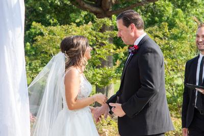 Bride and groom celebrate wedding at Omni Grove Park Inn Seely Pavilion