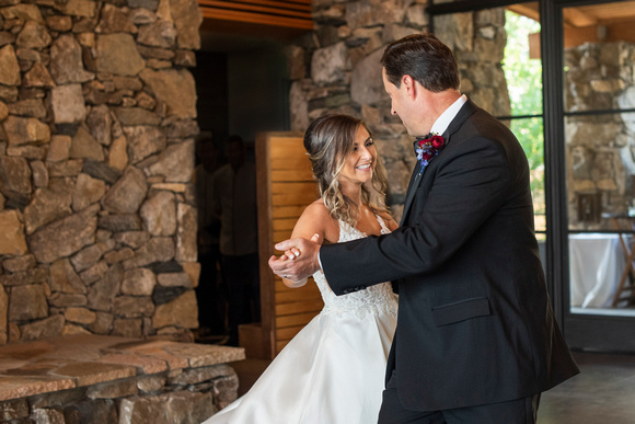 Bride and groom dancing at wedding at Omni Grove Park Inn Seely Pavilion