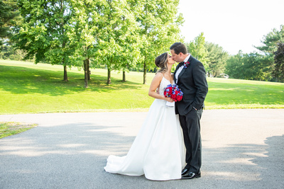 Bride and groom kissing at wedding at Omni Grove Park Inn Seely Pavilion