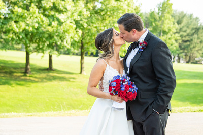 Bride and groom sharing a kiss at wedding at Omni Grove Park Inn Seely Pavilion