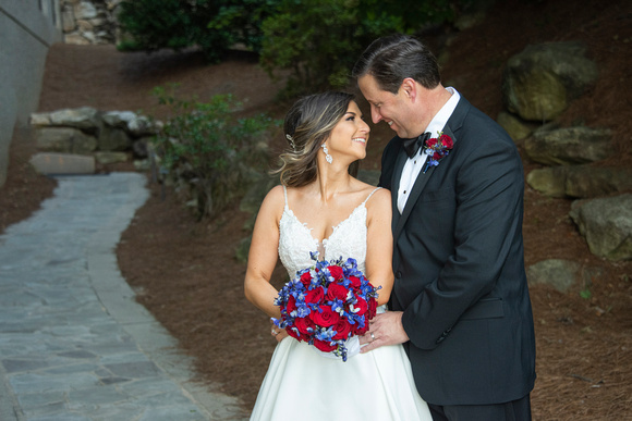 Bride and groom snuggling at wedding at Omni Grove Park Inn Seely Pavilion