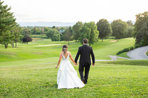 Bride and groom walking away at wedding at Omni Grove Park Inn Seely Pavilion