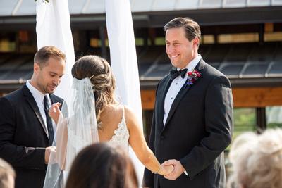 Groom during wedding at Omni Grove Park Inn Seely Pavilion