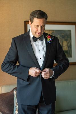 Groom getting ready at wedding at Omni Grove Park Inn