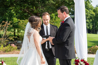 Ring ceremony at wedding at Omni Grove Park Inn Seely Pavilion
