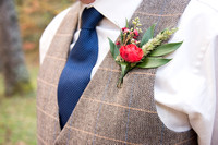 boutonniere with red flower fall lake logan wedding