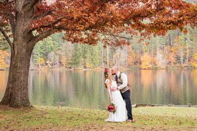 fall wedding couple at lake logan conference center