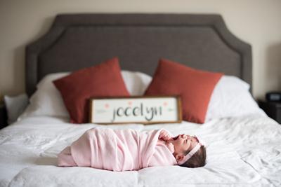 newborn baby photos on bed