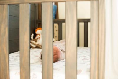Asheville newborn photographer baby in crib