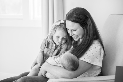 Asheville newborn photographer Mommy holding baby boy and big sister
