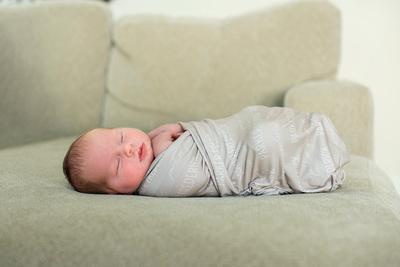 Asheville newborn photographer swaddled baby sleeping on back