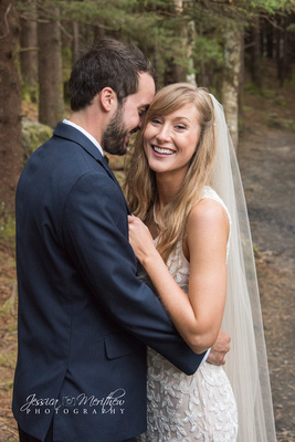 bride and groom navy suit lace dress mid length veil in roan mountain tennessee