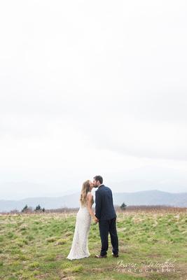 wedding couple kissing on mountain top roan mountain