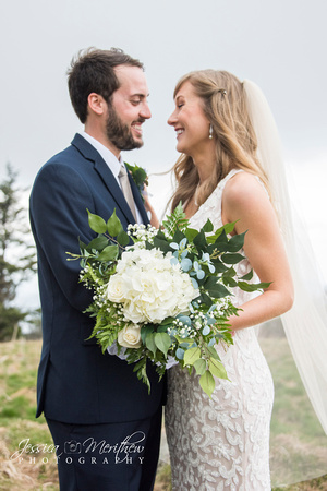 wedding couple photos on top of round bald in roan mountain