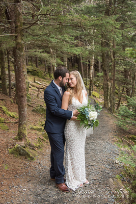 wedding couple serious face on hiking trail roan mountain