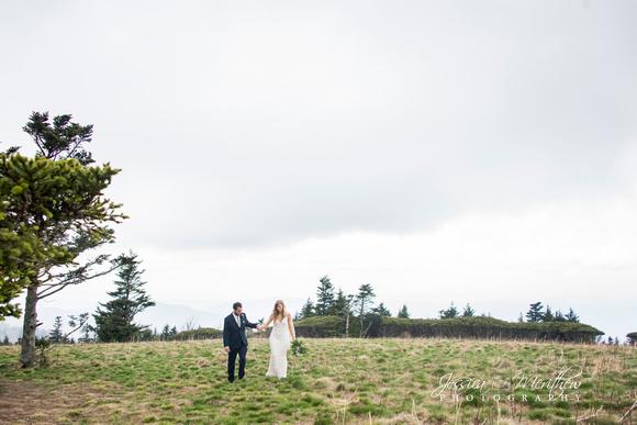 wedding couple walking on round bald in roan mountain views
