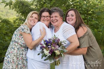 wedding party hug same sex couple