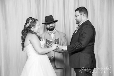 bride and groom in black and white during wedding ceremony at highland brewing
