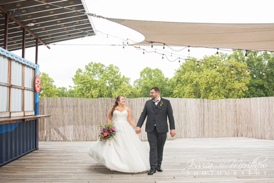 bride and groom walking on rooftop at highland brewing wedding in asheville