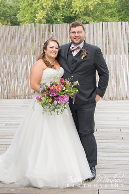 bride and groom with carolina flowers wildflower bouquet at highland brewing wedding