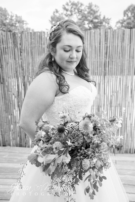bride in black and white with wedding bouquet at highland brewing