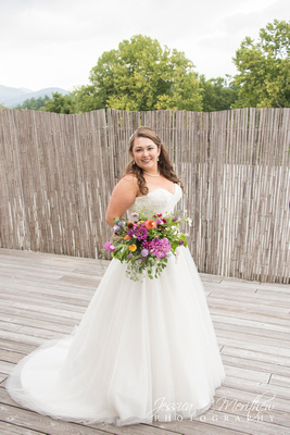 bride on rooftop at highland brewing wedding with mountain views