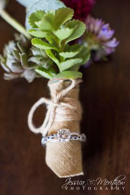 detail photo of boutonniere and engagement ring highland brewing wedding