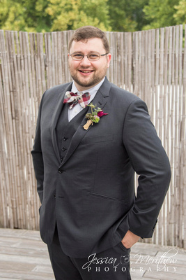 groom photo on rooftop at highland brewing wedding in asheville