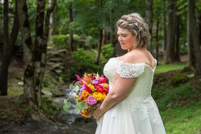 Bridal portrait next to creek at Hawkesdene wedding venue in Andrews NC near Asheville