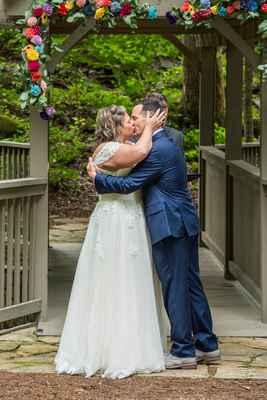 Bride and groom first kiss at Hawkesdene wedding venue in Andrews NC near Asheville