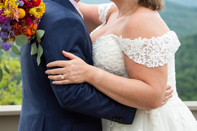 Bride and groom holding on to one another at Hawkesdene wedding venue in Andrews NC near Asheville
