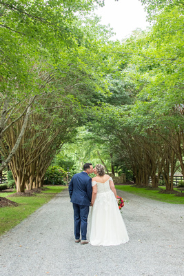 Bride and groom kissing at Hawkesdene wedding venue in Andrews NC near Asheville