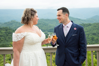 Bride and groom toasting at Hawkesdene wedding venue in Andrews NC near Asheville