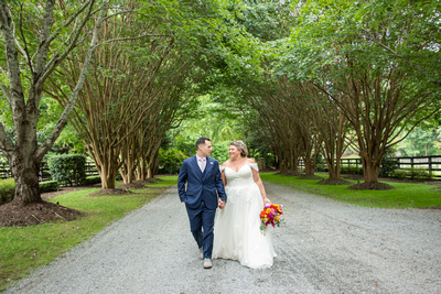Bride and groom walking together at wedding at Hawkesdene wedding venue in Andrews NC near Asheville