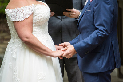 Couple holding hands during wedding ceremony at Hawkesdene wedding venue in Andrews NC near Asheville