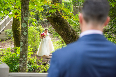 Bride walking down the aisle at wedding at Hawkesdene wedding venue in Andrews NC near Asheville