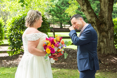 Groom wiping away a tear at Hawkesdene wedding venue in Andrews NC near Asheville