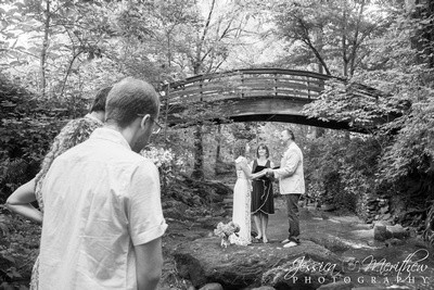 Older couple eloping with adult kids at Asheville Botanical Gardens