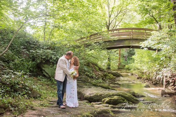 Wedding couple at creek in Botanical Gardens Asheville