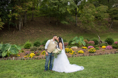 bride and groom portrait kissing at timber hall events in asheville