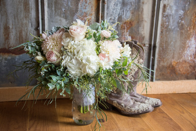 country wedding bouquet and brides boots
