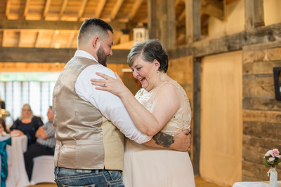 mother and son dancing at timber hall events wedding