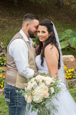wedding couple portrait with bouquet at timber hall events