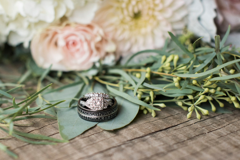 wedding rings on bouquet at timber hall events in asheville