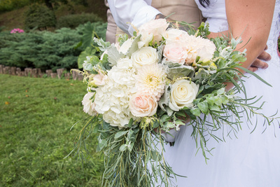 white and green wedding bouquet at timber hall events